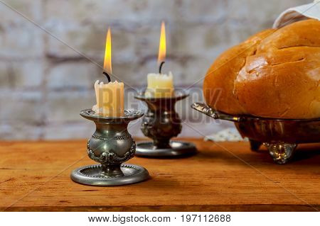 Shabbat With Lighted Candles, Challah Bread And Wine.