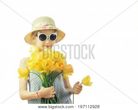 The girl hiding in the bouquet of flowers isolated on white background. Portrait of a girl with flowers isolated on white background.