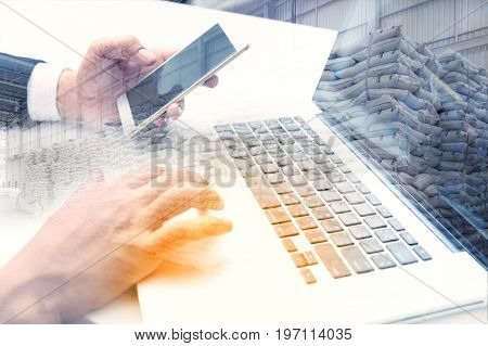 Double exposure of success businessman working management distribution in warehouse with digital tablet laptop computer and smart phone Logistic Import Export business.