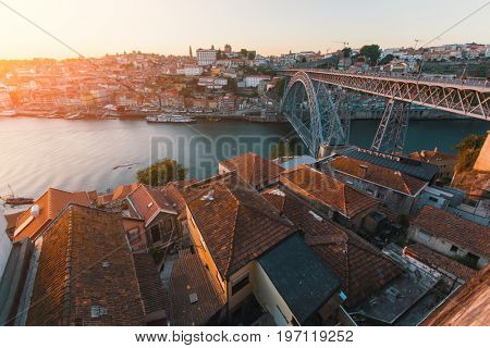 Bird's-eye view of Douro river and Dom Luis I bridge at sunset, Porto, Portugal.