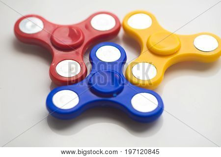 Hand Spinner. Stress relieving toy on white background. Close-up. Top view. Stock photo.
