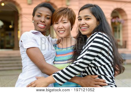 Three Multicultural Women Embracing Themselves