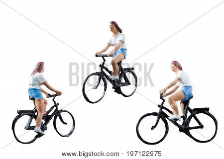 Miniature figure ride bicycle isolated on white background with clipping path