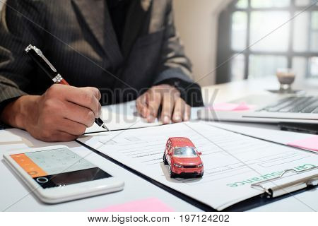 insurance agent sitting in office with transportation insurance or car insurance concept.