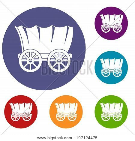 Ancient western covered wagon icons set in flat circle red, blue and green color for web