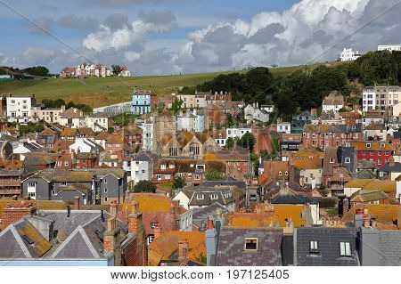 View of the roofs of Hastings old town from East Hill with West Hill in the background and beautiful clouds, Hastings, UK