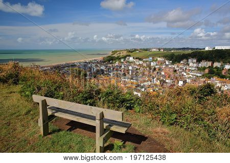 General view of Hastings old town from East Hill with a wooden bench in the foreground, Hastings, UK