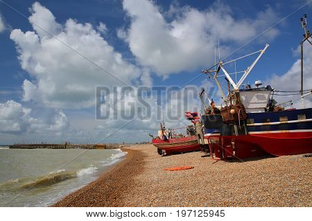 Beach launched fishing boats with a beautiful sky, Hastings, UK