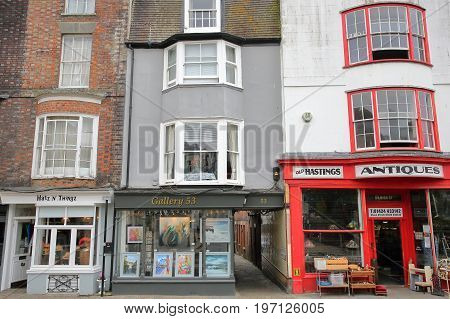 HASTINGS, UK - JULY 22, 2017: Colorful shops in High Street, Hastings Old Town