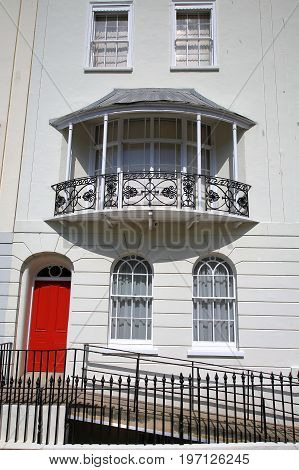 HASTINGS, UK - JULY 23, 2017: A Georgian house facade in the new town with wrought iron railing balcony