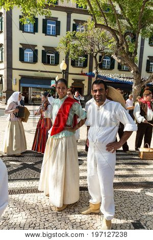 FUNCHAL PORTUGAL - SEPTEMBER 1 2016: Dancers with local costumes demonstrating a folk dance during the Wine Festival in Funchal on the Madeira Portugal.