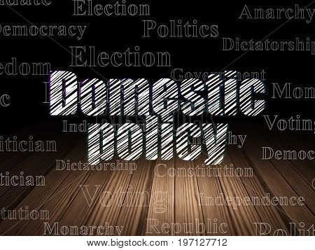Political concept: Glowing text Domestic Policy in grunge dark room with Wooden Floor, black background with  Tag Cloud