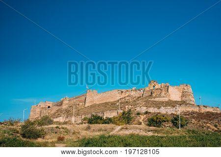Gori, Shida Kartli Region, Georgia. Gori Fortress Or Goris Tsikhe Is A Medieval Citadel Standing Above The City Of Gori On A Rocky Hill. Sunny Autumn Day With Blue Sky. Travel Destination, Panorama