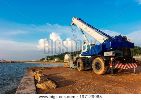 Mobile lifting crane at construction site., Heavy equipment