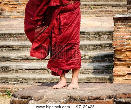 Buddhist Monk Standing At The Temple