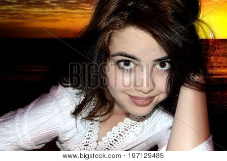 photography with scene of the beautiful asiatic girl on background of the sea sundown