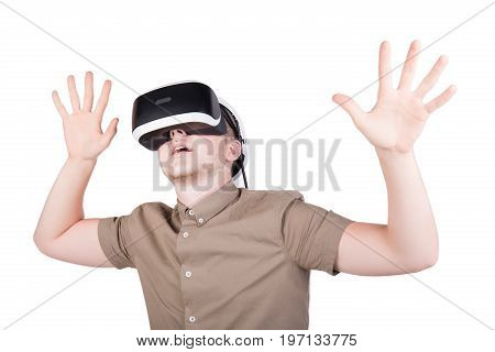 Close-up portrait of a frightened or amazed man wearing virtual reality goggles and playing virtual reality game, isolated on a white background. Digital VR device. Professional audio equipment.