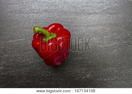 Red sweet pepper. Sweet Pepper are rich sources of antioxidants and vitamin C.Top view with copy space. Dark background.