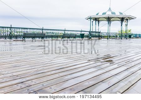 Quebec City, Canada - May 30, 2017: Old Town View Of Dufferin Terrace Wooden Boardwalk With Benches,