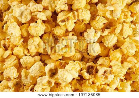 Popcorn texture background close-up. Pile of yellow and plain popcorn
