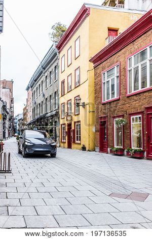 Quebec City, Canada - May 30, 2017: Blue Tesla Model X Driving On Cobblestone Road In Lower Old Town