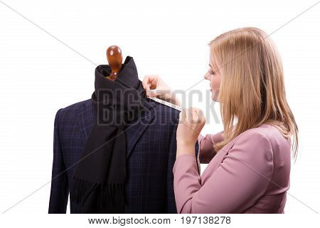 Freelancer - Fashion designer or Tailor working on a design or draft, she takes measure on a dressmakers dummy isolated on white background