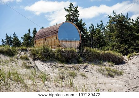 Europe Latvia Cape Kolka. House in the form of a barrel on the dunes for a double stay at the coast of the Baltic Sea.