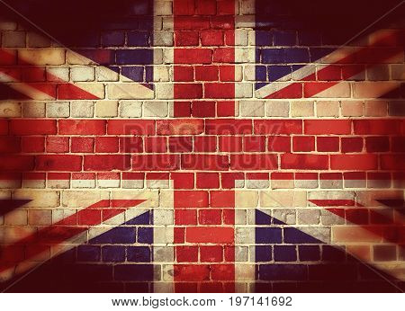 Vintage Union flag on a brick wall with vignette