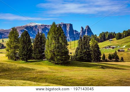 The natural landscape of the Alps di Siusi. Wonderful quiet mountain valley in autumn. The  Dolomites - World Natural Heritage. Concept pedestrian and eco-tourism