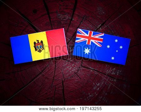 Moldovan Flag With Australian Flag On A Tree Stump Isolated