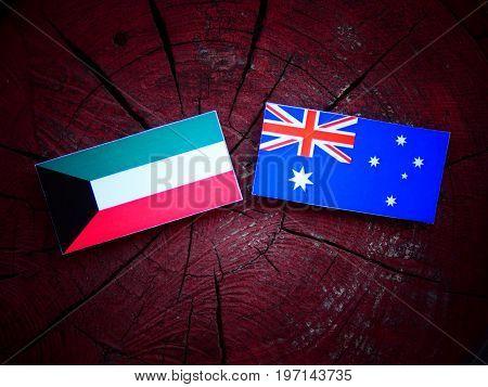 Kuwaiti Flag With Australian Flag On A Tree Stump Isolated