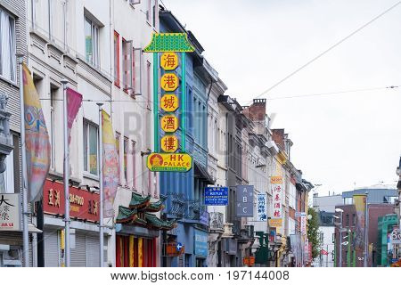ANTWERP BELGIUM - OCTOBER 2 2016: View on the Van Wesenbeekstreet a neighborhood filled with chinese and othe asian shops and restaurants