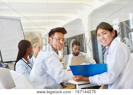 Students in medical school seminar learn together in cooperation