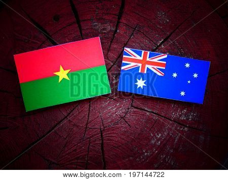 Burkina Faso Flag With Australian Flag On A Tree Stump Isolated