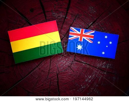 Bolivian Flag With Australian Flag On A Tree Stump Isolated