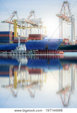 Logistics and transportation of International Container Cargo ship in a harbor with water reflections Freight Transportation Shipping Nautical Vessel