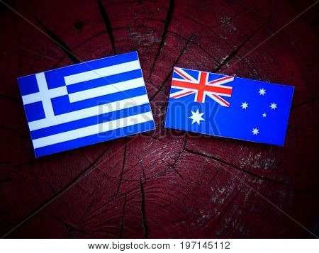 Greek Flag With Australian Flag On A Tree Stump Isolated