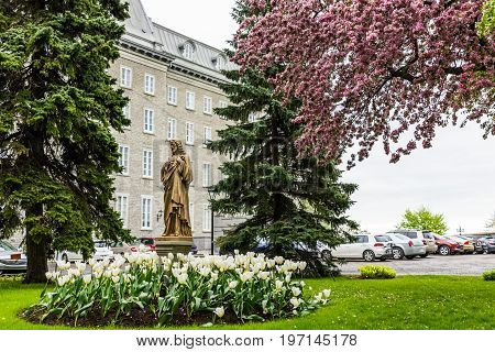 Quebec City, Canada - May 30, 2017: View Of Seminary Parking Lot With Golden Statue Of Jesus Christ