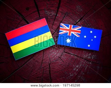 Mauritius Flag With Australian Flag On A Tree Stump Isolated