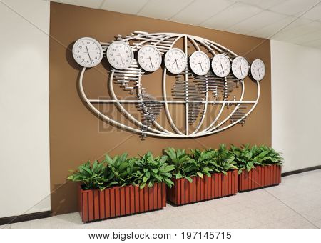 Wall with world map and clocks showing time in different cities