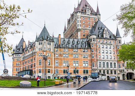 Quebec City, Canada - May 30, 2017: Old Town Street And View Of Hotel Chateau Frontenac With People