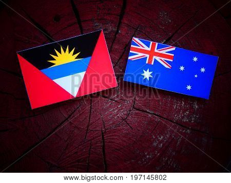 Antigua And Barbuda Flag With Australian Flag On A Tree Stump Isolated