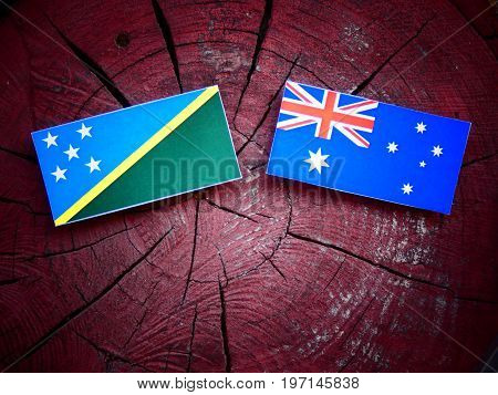 Solomon Islands Flag With Australian Flag On A Tree Stump Isolated
