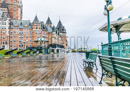 Quebec City, Canada - May 30, 2017: Old Town Street And View Of Hotel Chateau Frontenac With Cannons