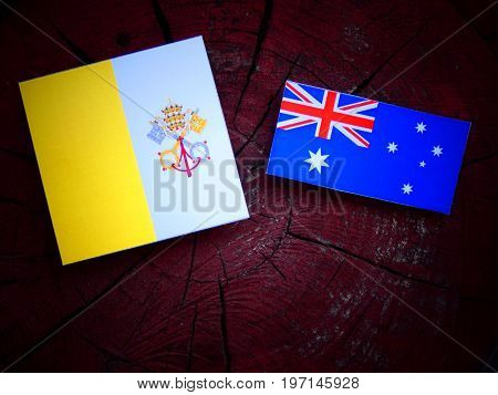 Vatican Flag With Australian Flag On A Tree Stump Isolated