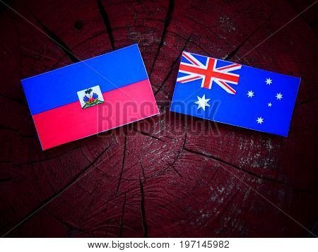 Haitian Flag With Australian Flag On A Tree Stump Isolated