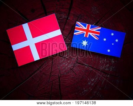 Danish Flag With Australian Flag On A Tree Stump Isolated