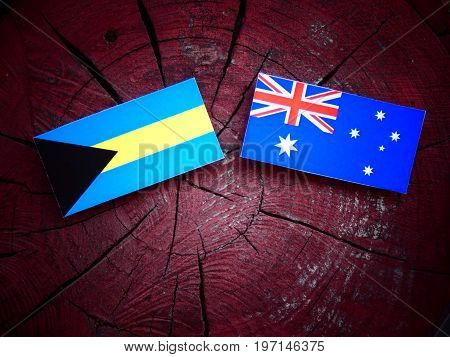 Bahamas Flag With Australian Flag On A Tree Stump Isolated