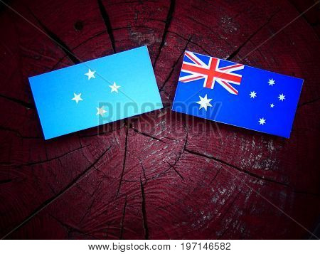 Micronesian Flag With Australian Flag On A Tree Stump Isolated