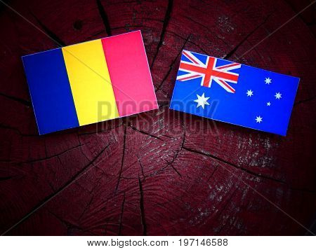 Romanian Flag With Australian Flag On A Tree Stump Isolated